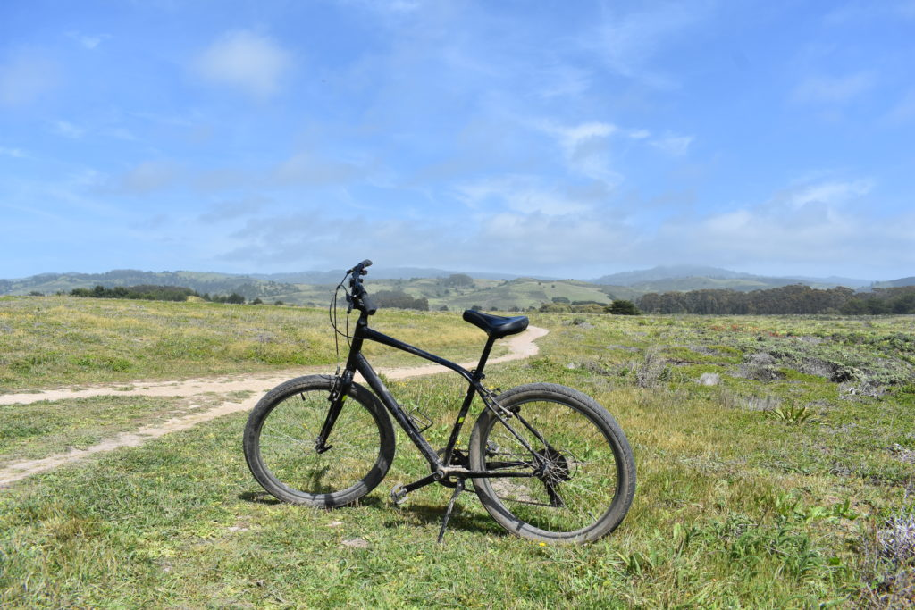 Bike with beautiful view of Santa Cruz Mountains and dream biking and hiking trails in the background of Half Moon Bay