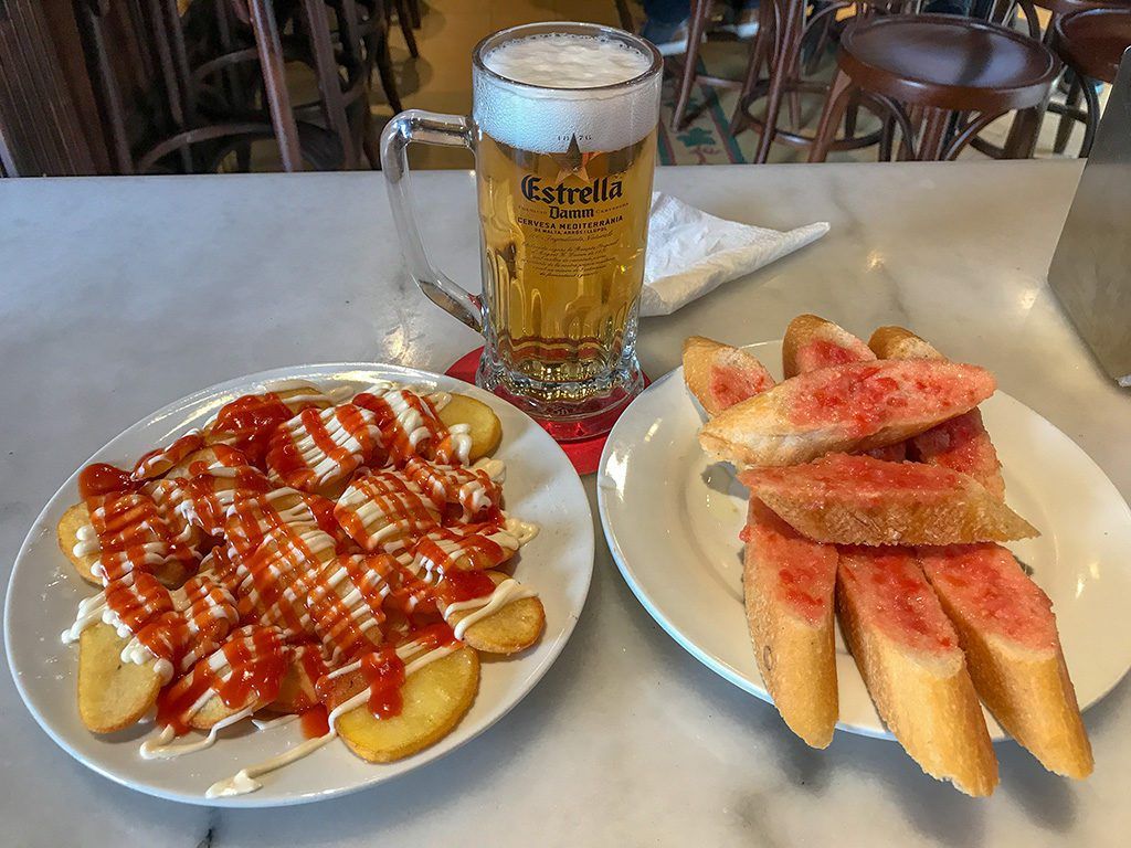 patatas bravas and pan con tomate is a must during a long weekend in Barcelona
