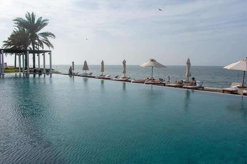 The Chedi Pool blends into the Gulf of Oman.
