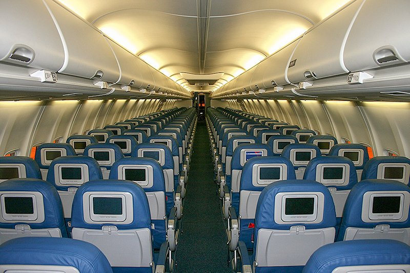 Choosing your seats wisely is one of the best travel hacks for flying. This is an airplane cabin with 3-3 seat configuration.