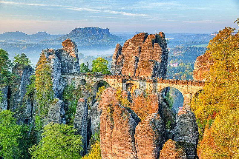 Bastei Bridge is a unique rock formation that lies along the Elbe River. It's accessible via train, bus or boat from Dresden.