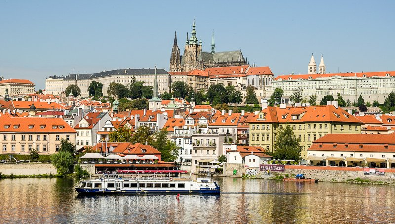 The Prague Castle majestically watches over the Charles Bridge and Vltava River below.