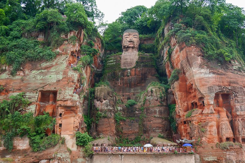 The Leshan Giant Buddha in China is absolutely massive. It's among the most popular heritage sites in China.