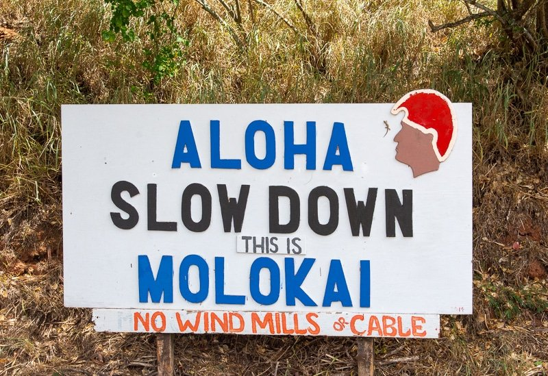 In this travel guide of Molokai, it's important to point out that this is the very first sign you'll see on the island.