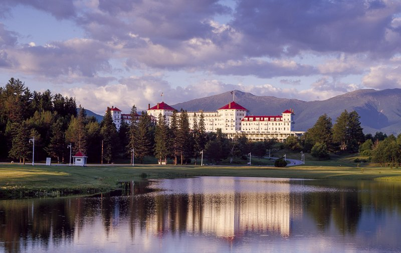 The Omni Mount Washington Resort is a great place to stop by for lunch, a drink, and to admire its splendid property.