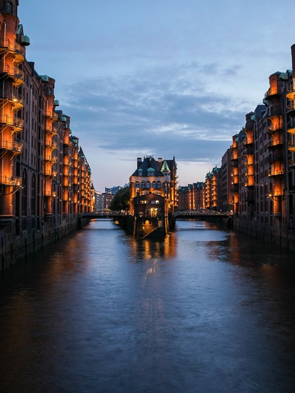 "The Speicherstadt is beautiful during ""blue hour,"" right after sunset, when the lights switch on!"