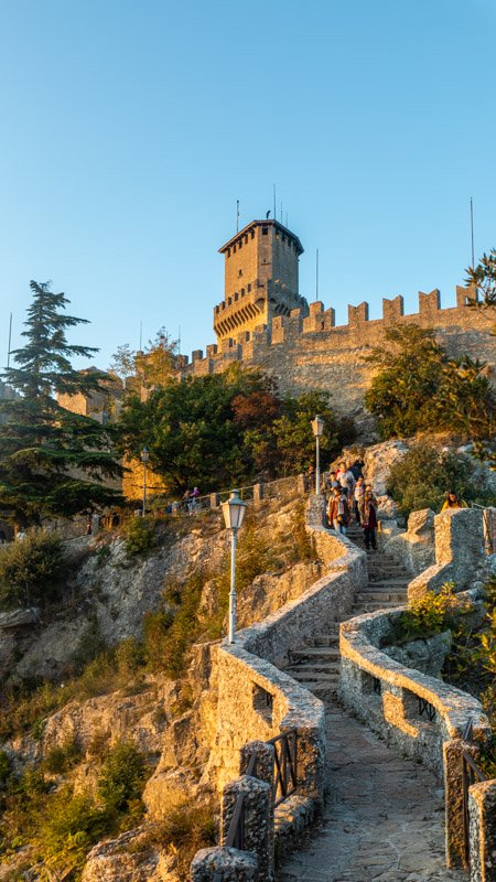 Towers illuminated at sunset in San Marino on a day trip from Bologna