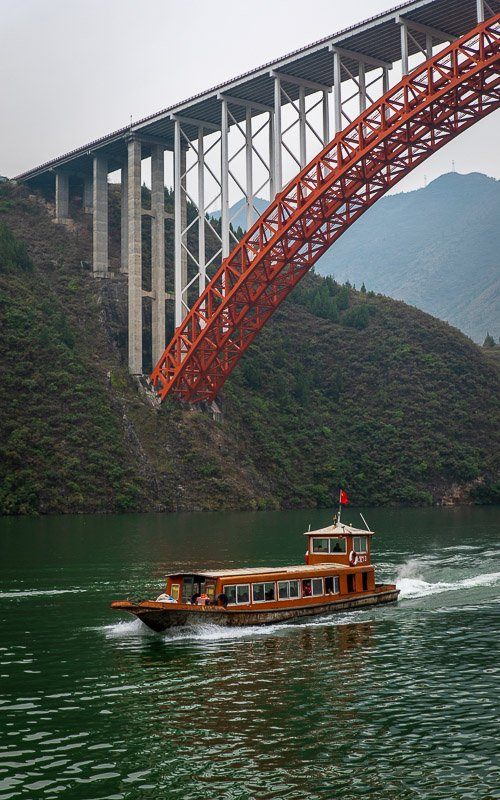 Small river boats are needed to traverse the Mini Three Gorges, a tributary of the Yangtze River.