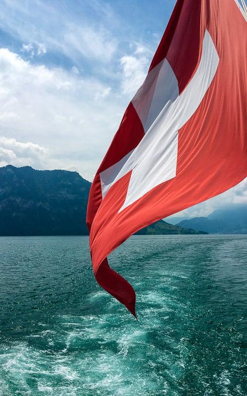 Lake Thun and Swiss flag.