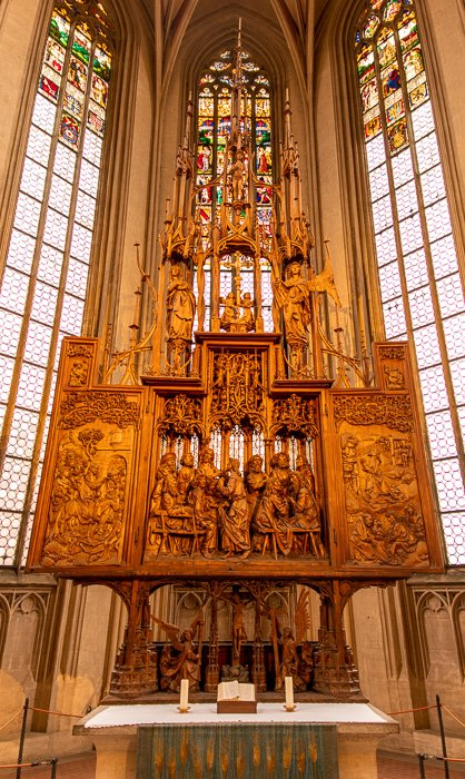 The Altar of the Holy Blood was carved by Tilman Riemenschneider, a famous German sculpture and wood carver from the 15th century.