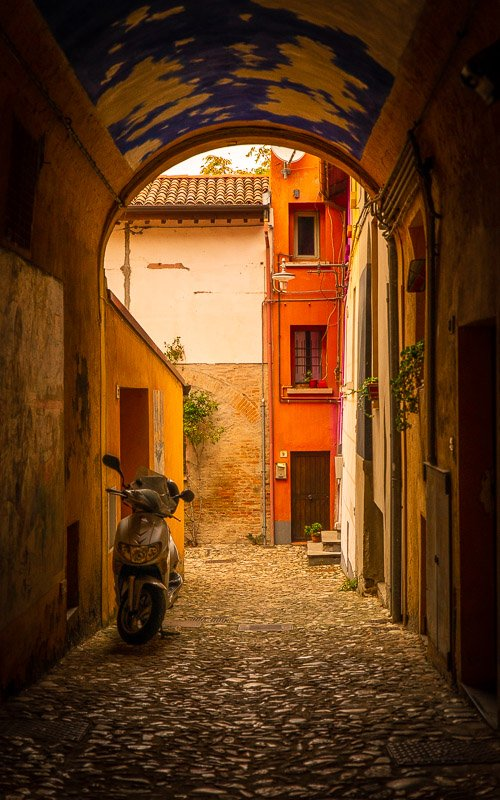 Dozza is so vibrant and colorful that it makes you wonder if each of the homes inside its old walls are also splashed with paint during the Biennale del Muro Dipinto.