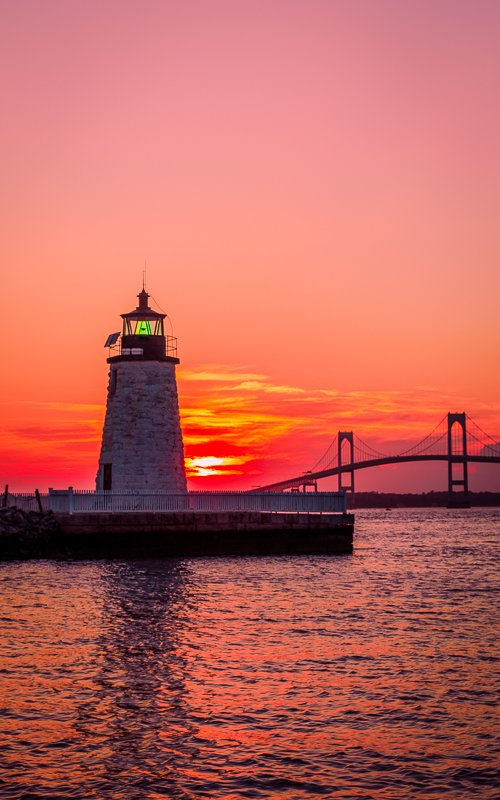 View of Newport Harbor Lighthouse and Claiborne Pell Bridge.