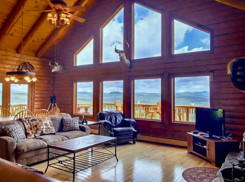 log cabin overlooking the white mountains of new hampshire.