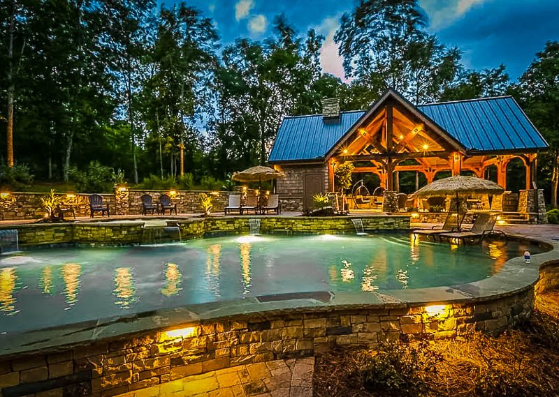 A lakefront Airbnb in Georgia with a beautiful pool and hot tub.