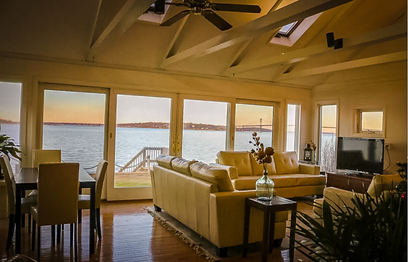 An oceanfront beach house Airbnb in Portsmouth, Rhode Island.