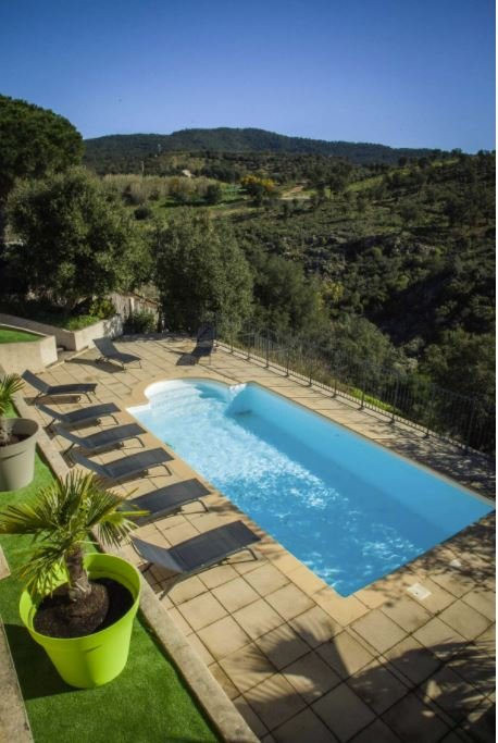 A beautiful pool with views of the French countryside