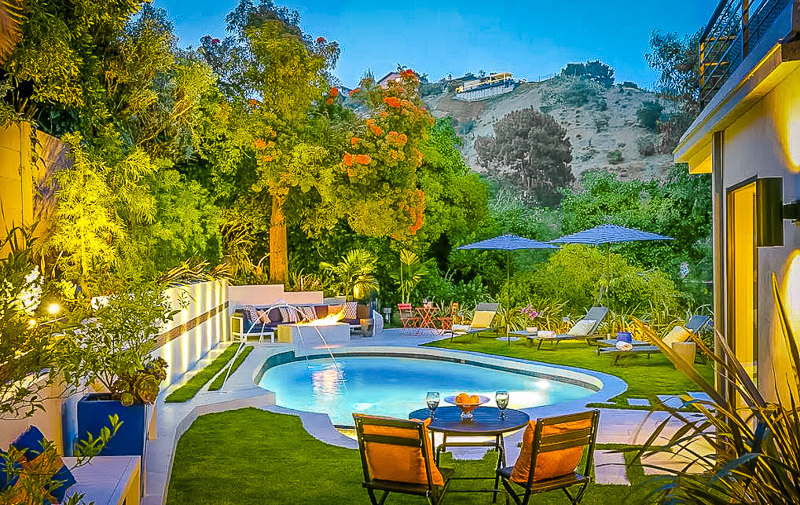Pool and outdoor seating area with views of Beverly Hills