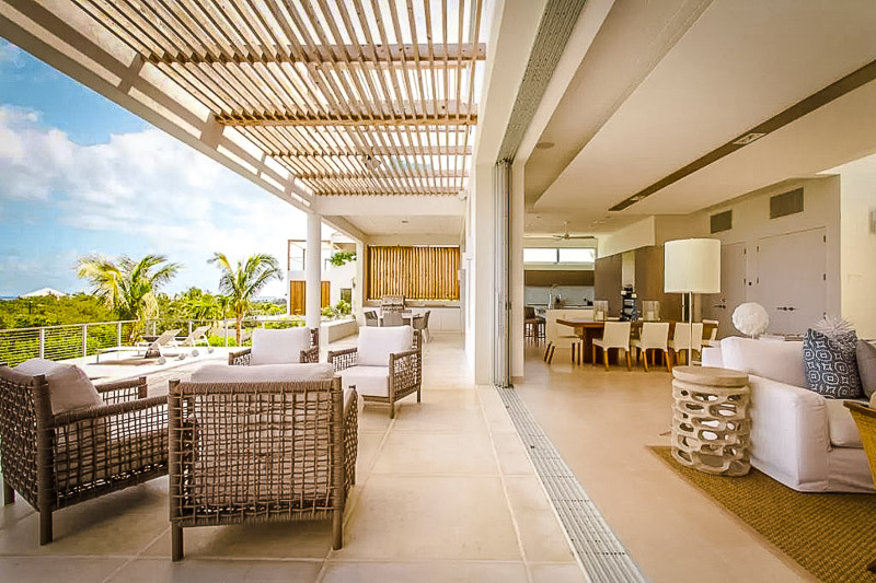 A homey and decked out accommodation overlooking the Caribbean
