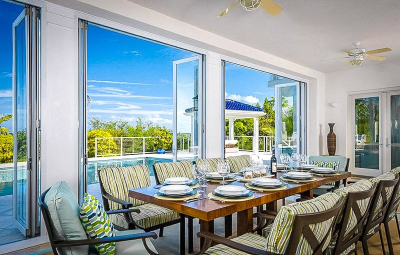 Beautiful dining room area overlooking the pool