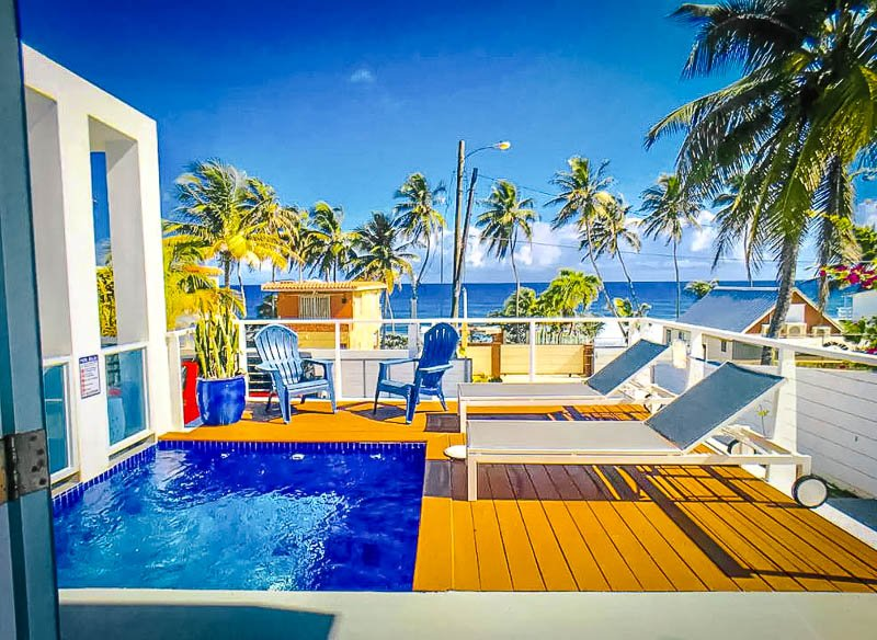 A pool deck with beautiful views of the Caribbean Sea