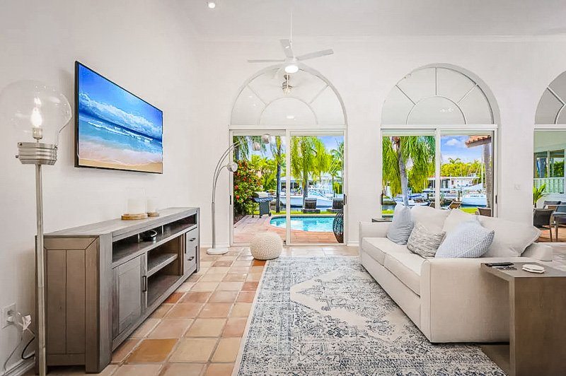 Living room with views of the pool and waterfront