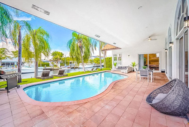 Outdoor pool and patio in North Miami. This is definitely among the best mansion rentals in Miami.