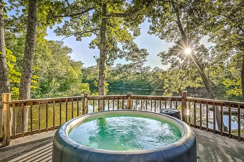Hot tub with a view of the lake.