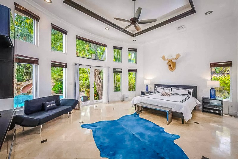 Master bedroom with the best views of the pool area and surrounding palm trees