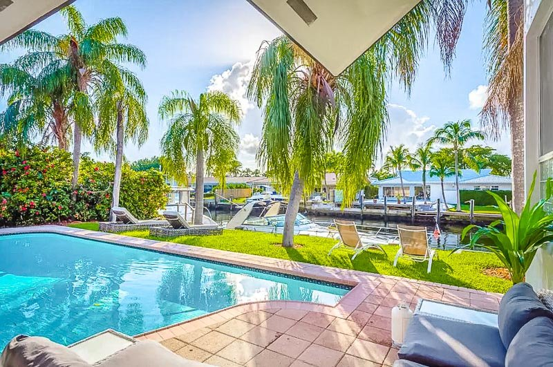 A beautiful Airbnb mansion rental in Miami with views of the pool and water.