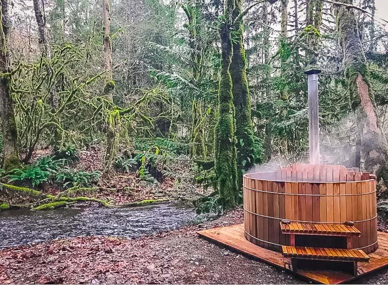 Soak in the wood-fired cedar hot tub beneath the stars.