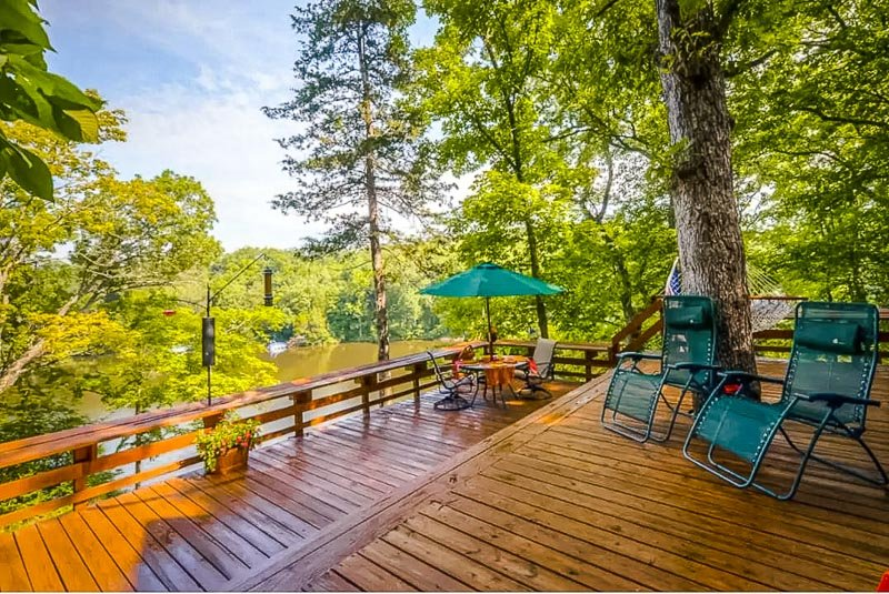 Outdoor patio with views of the lake. One of the most romantic cabins for rent in the Midwest