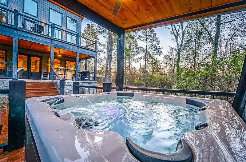 Hot tub surrounded by wilderness.