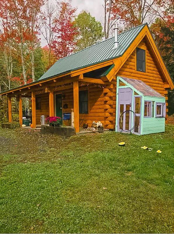 Log cabin on an expansive wooded property in Stowe.