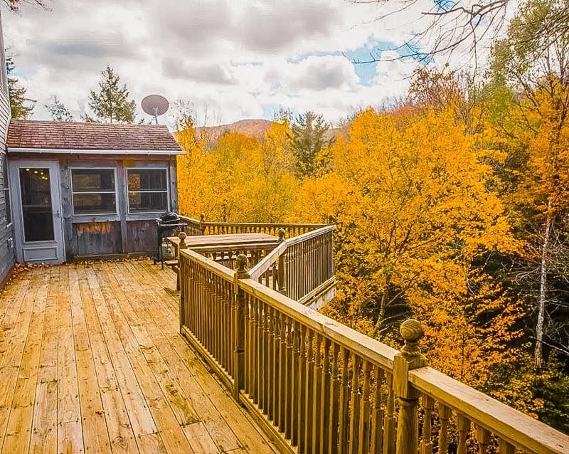 Wraparound porch with stunning autumn views.