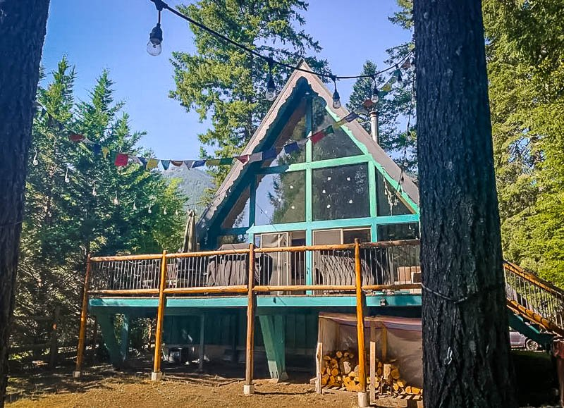 A cozy A-Frame cabin in the wilderness.