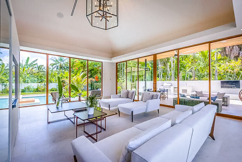 Beautifully designed living space with floor to ceiling windows