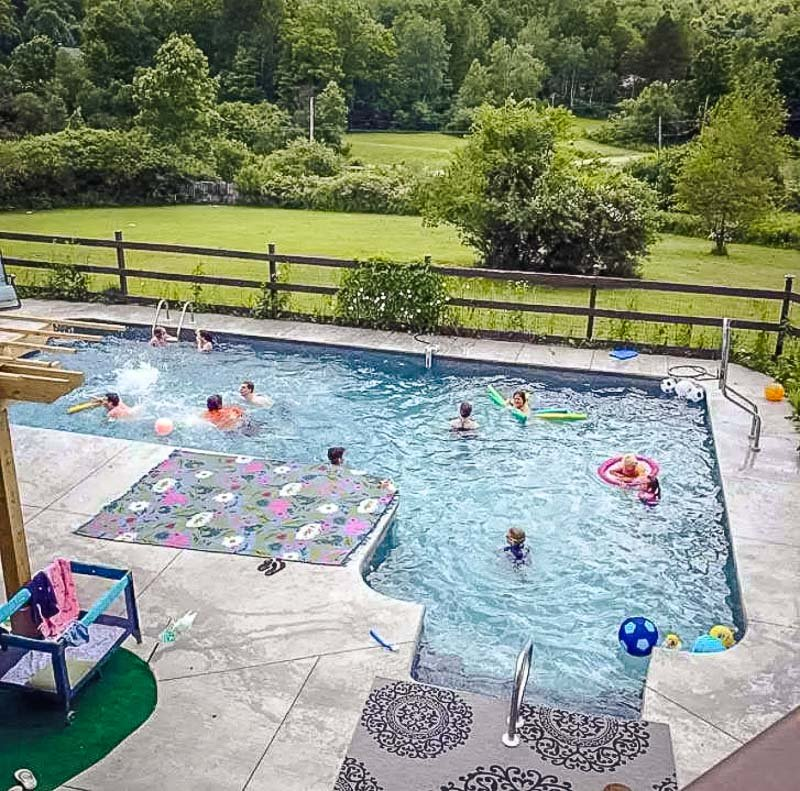 Outdoor swimming pool at this Finger Lakes cabin rental.