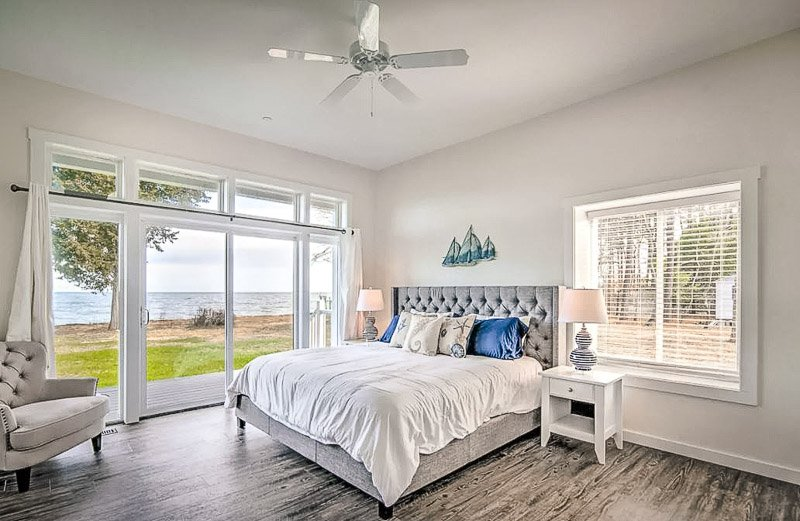 Cozy yet casual bedroom with views of the waterfront