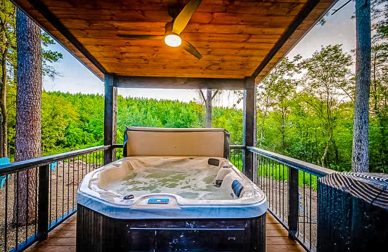 Hot tub with a whirlpool and a view.