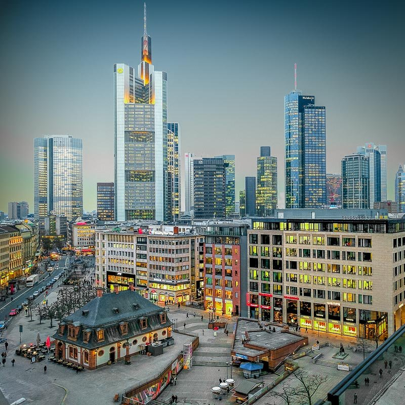 Frankfurt is a bustling financial center in Europe with cheap flights from the US and other countries.