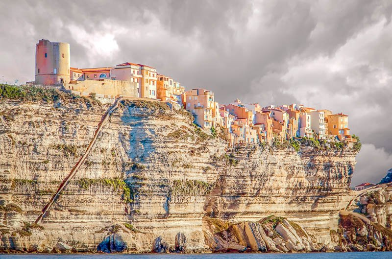 Bonifacio is a medieval town in Corsica that dangles above the cliffs