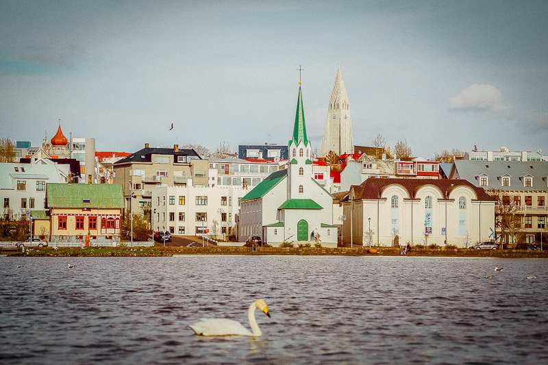 Reykjavik, Iceland is easy and cheap to fly to from the US.