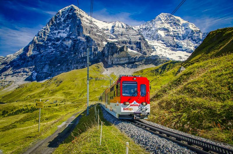 A train ride through the Swiss Alps is the ultimate travel bucket list idea.