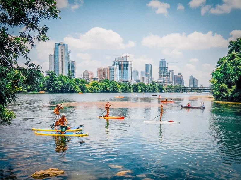 Paddle boarding in Austin, one of the best places to travel with friends