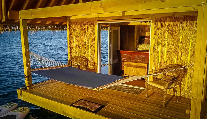 Back deck with a hammock overlooking the water.