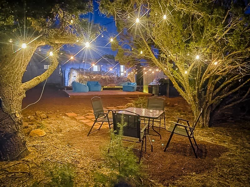 Glistening lights in the outdoor picnic seating area.
