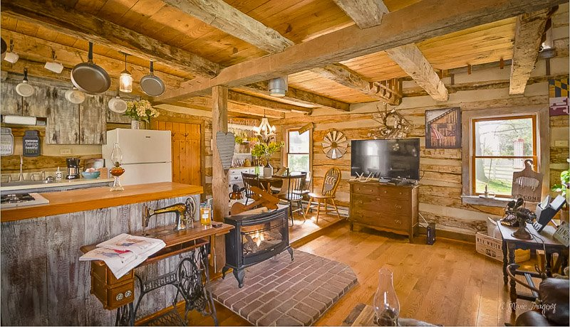 Rustic log cabin furnishings and cozy fireplace