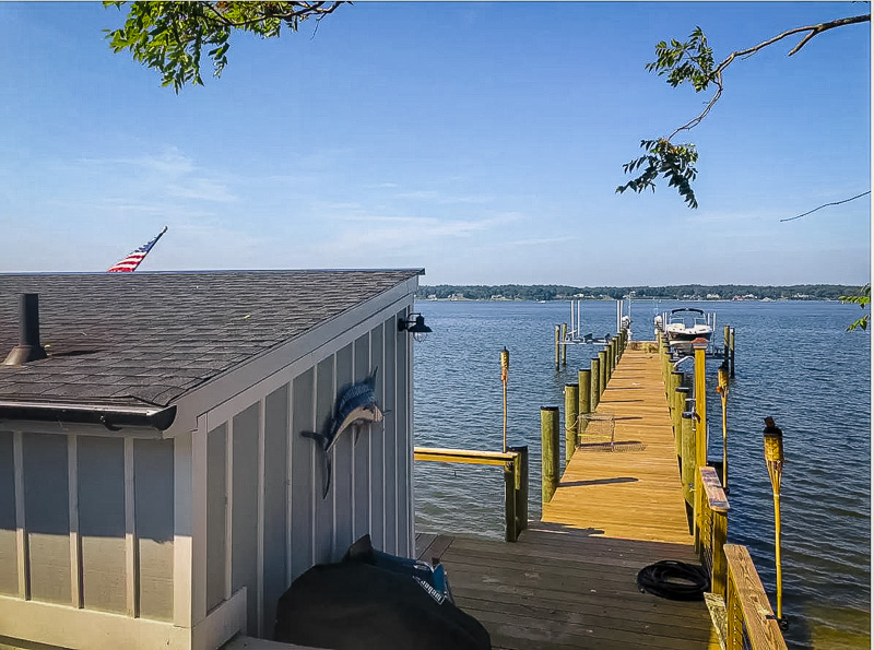 Private dock and pier with pontoon boat.
