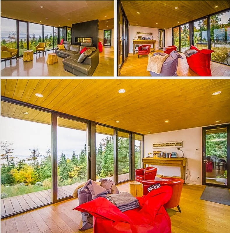 Modern living room with forest views.