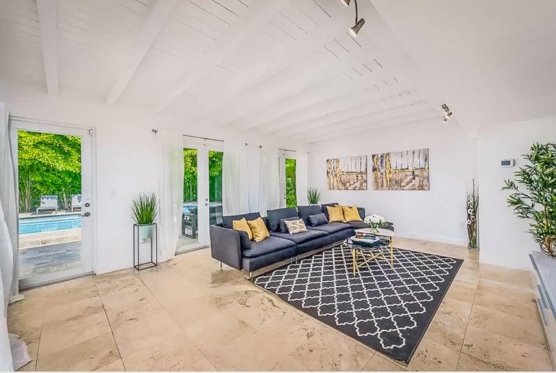 Spacious living room facing the pool area